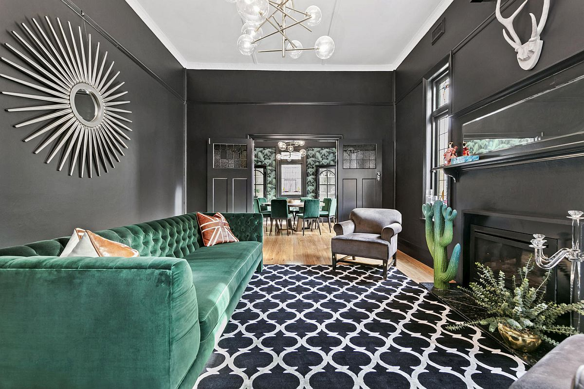 Gorgeous use of gray coupled with Emerald Green inside the posh Melbourne living room