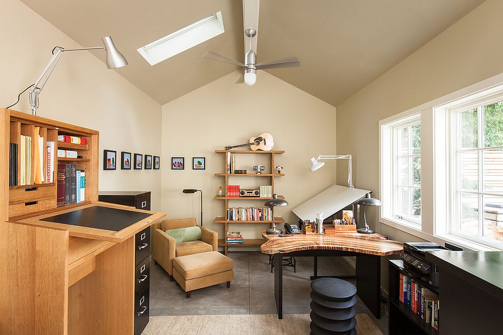 Gorgeous writer's studio with skylights is filled with ample natural light