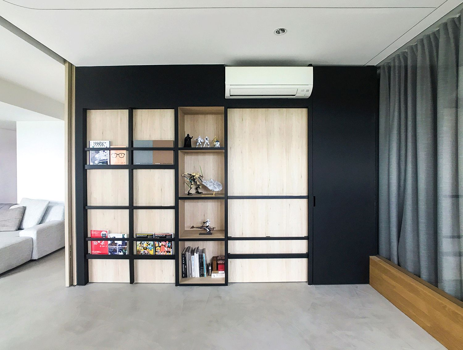 Innovative apartment turns even doors into shelving space!