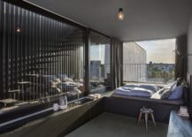 Light-filled-and-relaxing-penthouse-bedroom-with-stairway-next-to-it-217x155
