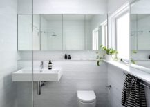 Lovely-use-of-white-tiles-brings-texture-into-the-bathroom-217x155
