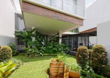 Lush-green-backyard-of-the-Long-House-with-wooden-planters-217x155