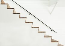 Minimal-and-sculptural-stairway-in-wood-for-the-contemporary-interior-217x155