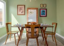 Modern-midcentury-dining-room-with-giant-mirror-standing-against-the-wall-217x155