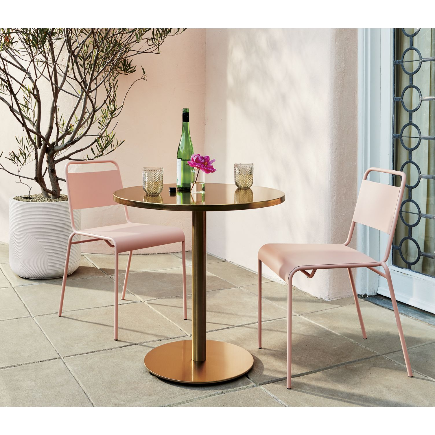 Peachy pink patio furniture from CB2
