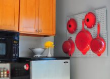 Pegboard-with-bright-red-pots-and-pans-steals-the-show-in-this-eclectic-kitchen-217x155