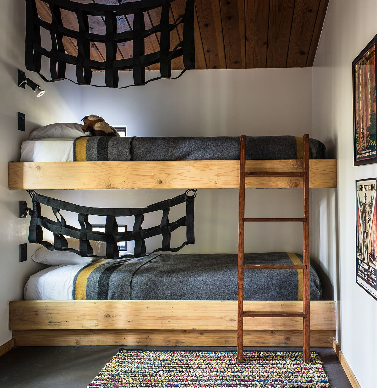 Playful bunk beds along with pullout beds save space inside the cabin bedrooms