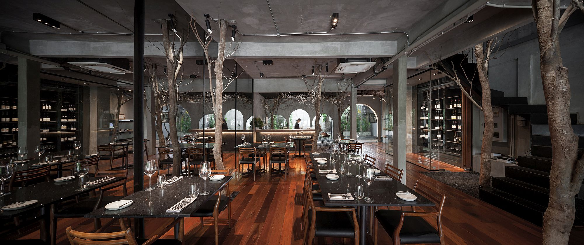 Randomly placed indoor trees bring nature into this restaurant