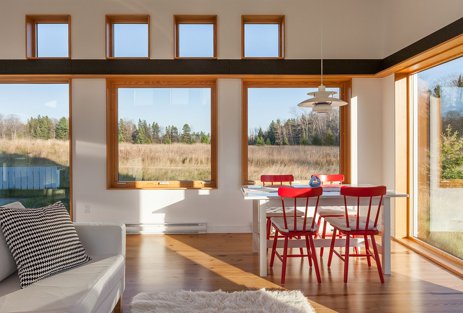 Red-dining-table-chiars-bring-pop-of-brightness-to-the-dining-room