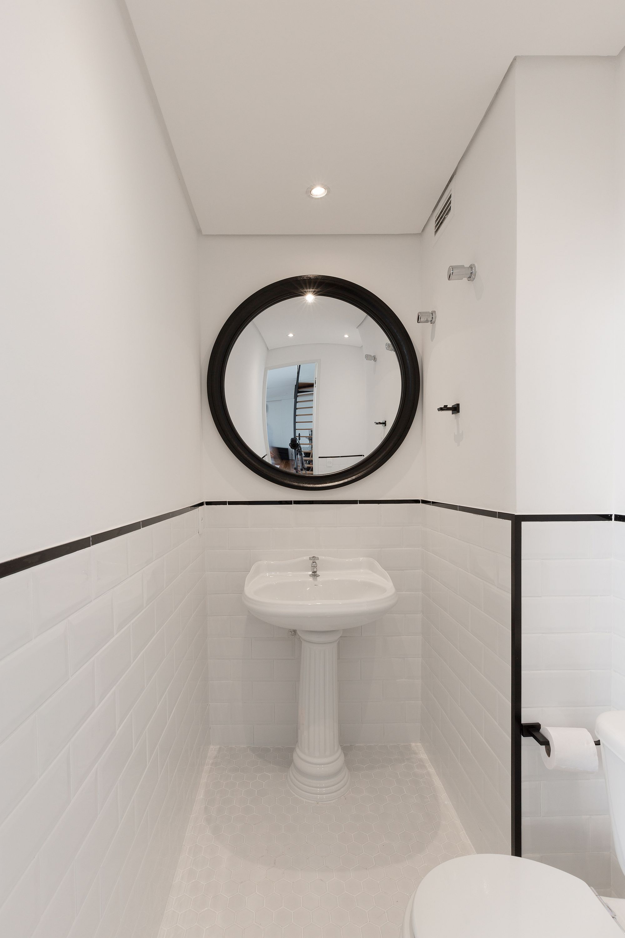 Revamped tiny toilet in white with a dash of black