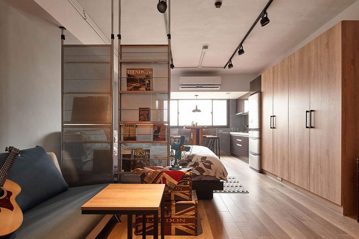 Room divider also acts as a bookstand inside this tiny apartment