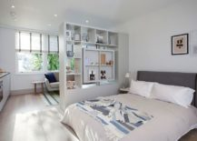 Scandinavian-style-bedroom-with-a-room-divider-that-doubles-as-a-cool-display-217x155