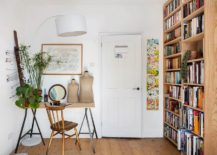 Scandinavian-style-home-office-with-large-open-wooden-bookshelf-217x155