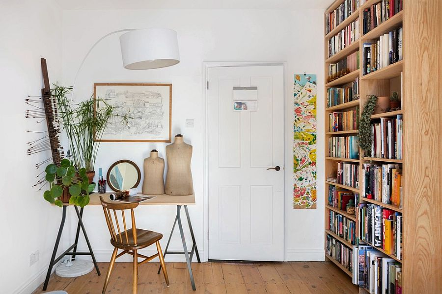 Scandinavian style home office with large, open wooden bookshelf