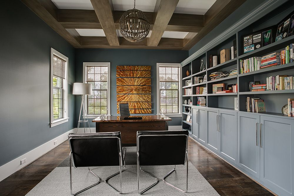 Series of bluish-gray shelves and cabinets create ample storage space inside this dashing home office