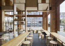 Series-of-wood-and-steel-benches-alongw-ith-wooden-stools-inside-the-cafe-217x155