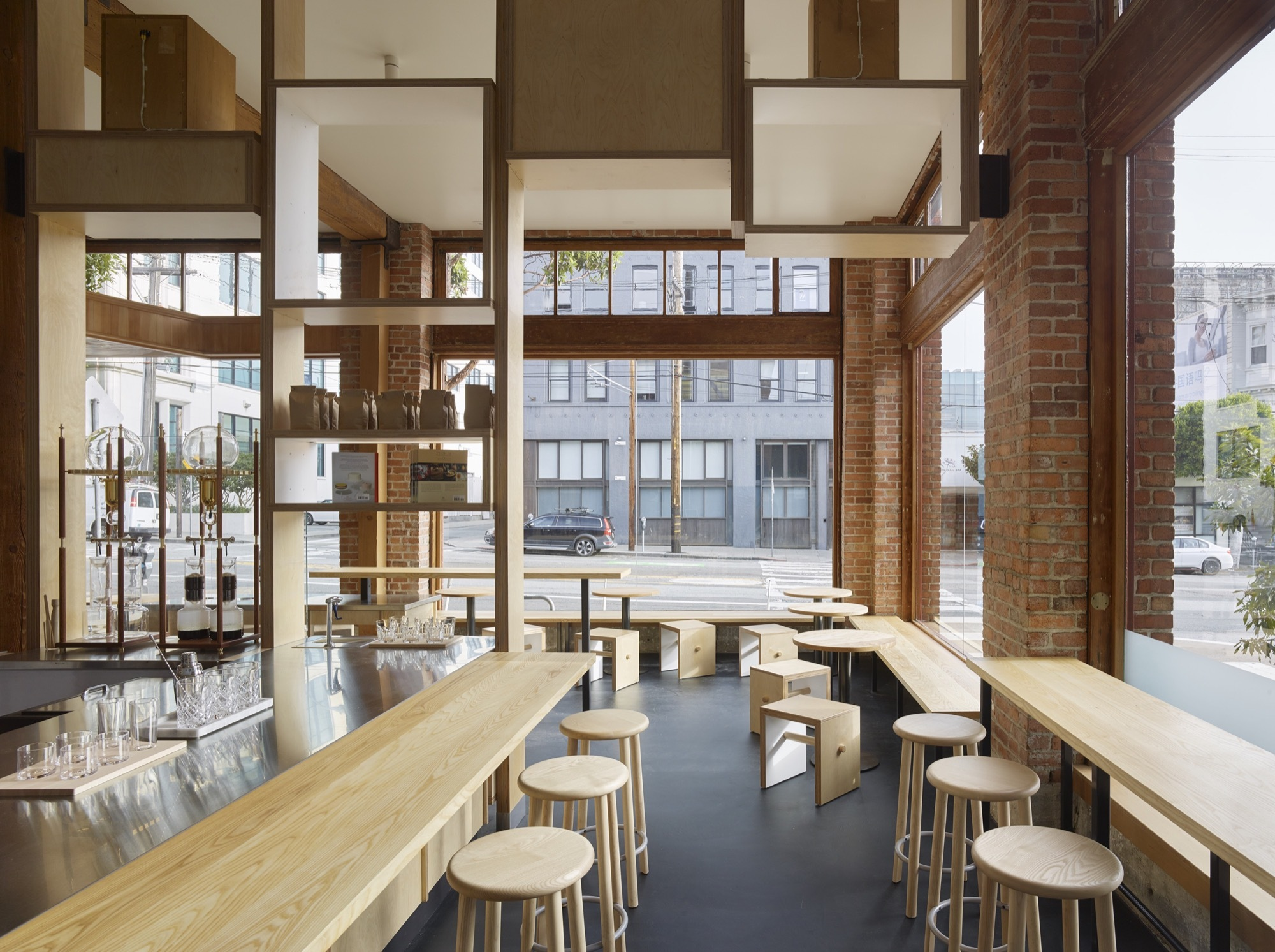 Series-of-wood-and-steel-benches-alongw-ith-wooden-stools-inside-the-cafe