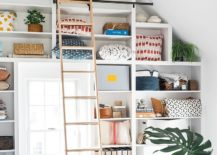 Shelves-with-ladder-allow-you-to-make-the-most-of-the-vertical-space-in-the-home-office-217x155
