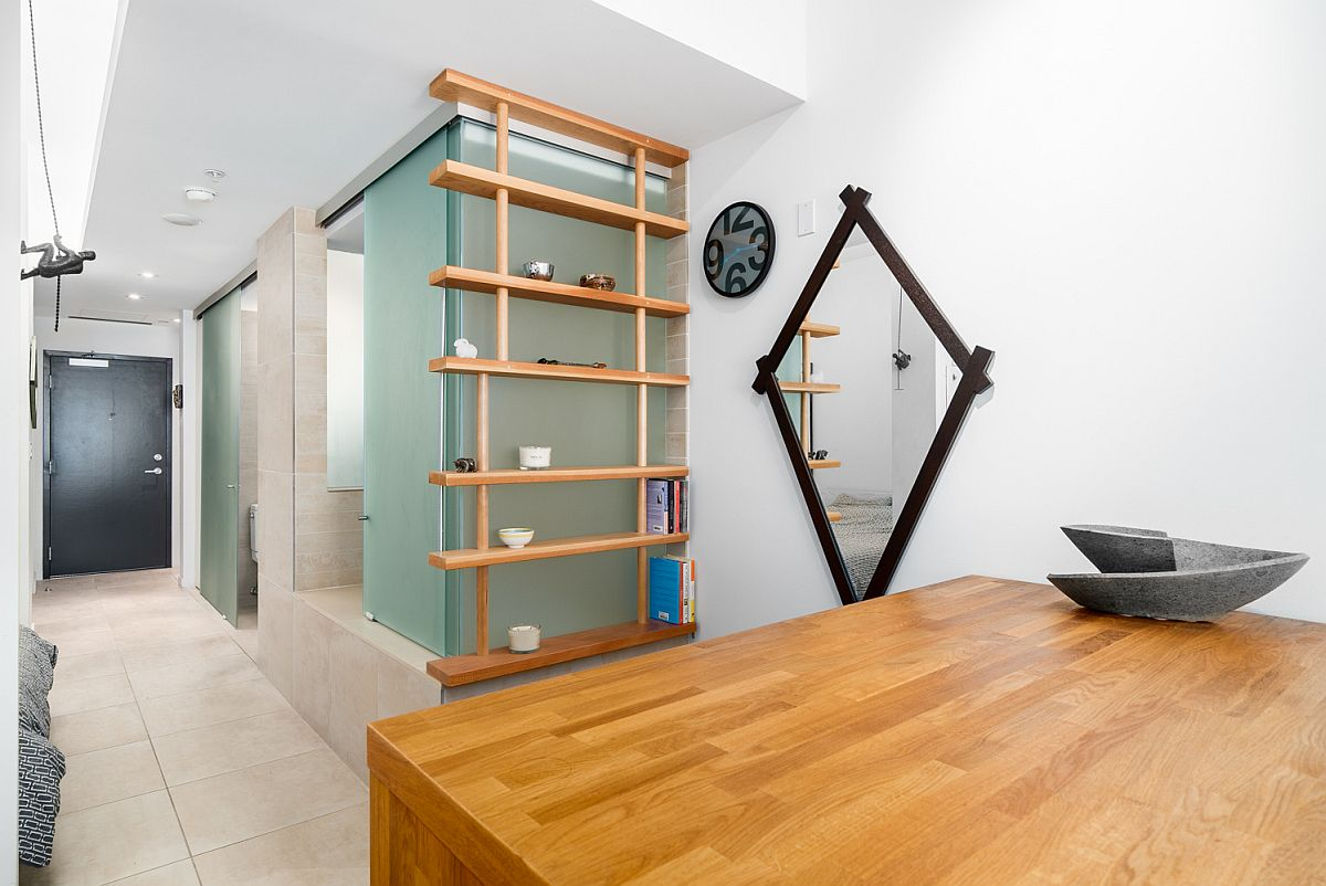 Slim-wooden-shelf-next-to-the-glass-panels-becomes-a-lovely-display-area
