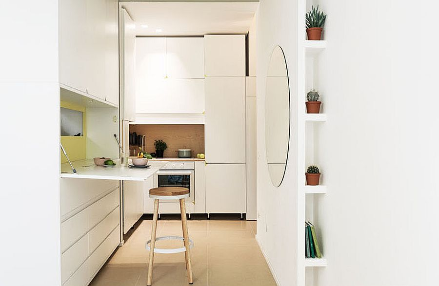 Small fold-out work desk and dining space inside the small apartment