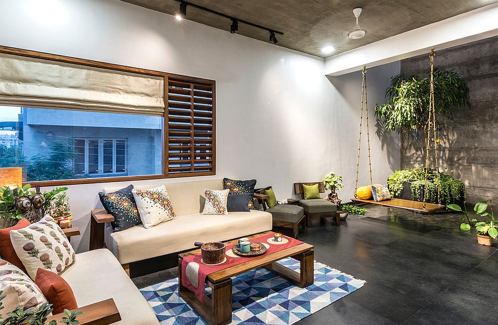 Small rug defines the living room in this Asian style home