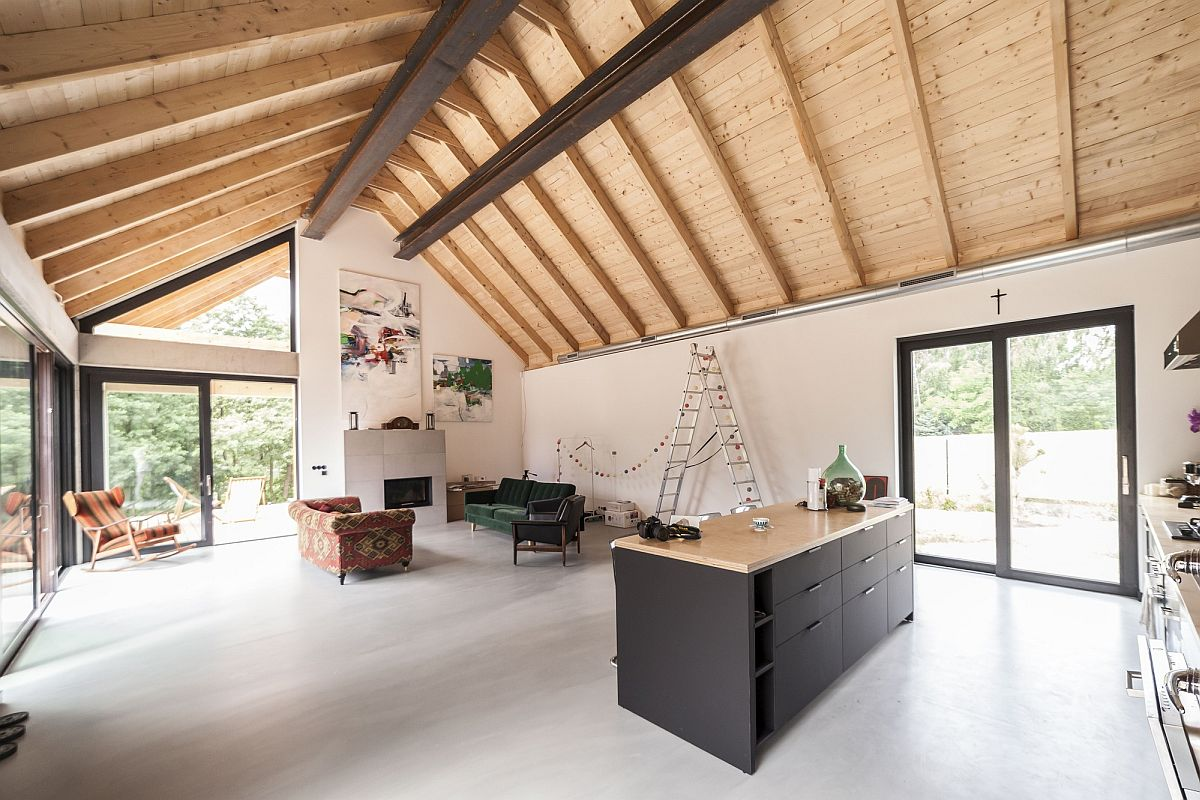 Spacious-double-height-living-area-with-kitchen-at-one-of-its-ends