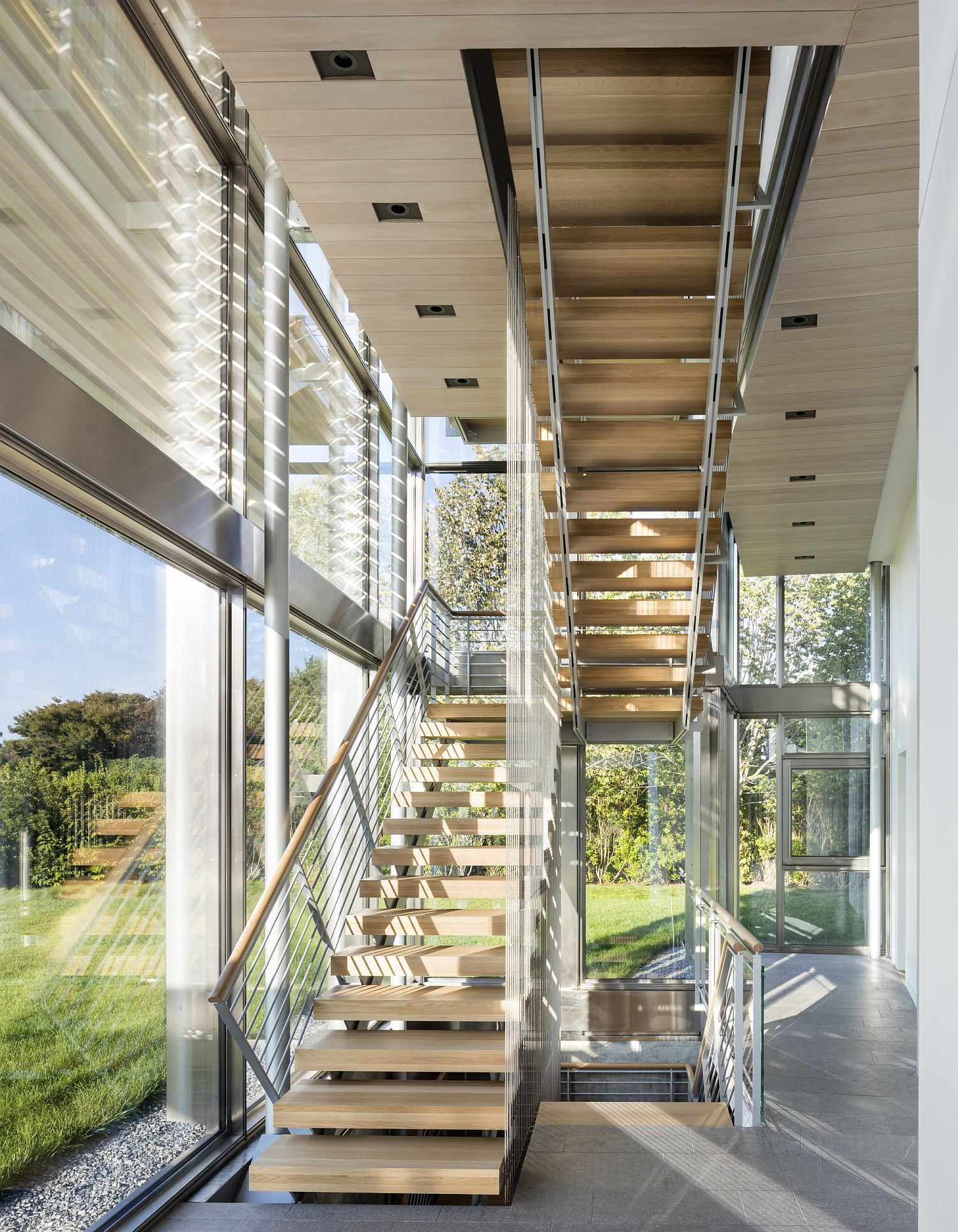 Staircase in wood connecting different level of the home