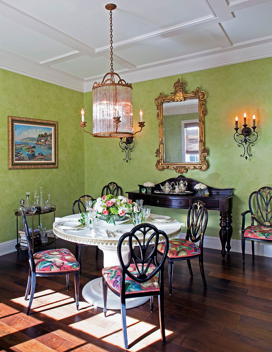 Traditional dining room in green with ample natural light
