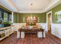 Transitional-dining-room-in-white-and-green-with-wooden-dining-table-and-shelving-with-distressed-finish-217x155