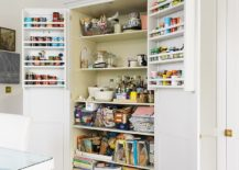Tucking-away-excess-kitchenware-and-supplies-intothe-pantry-gives-the-kitchen-an-organized-look-217x155