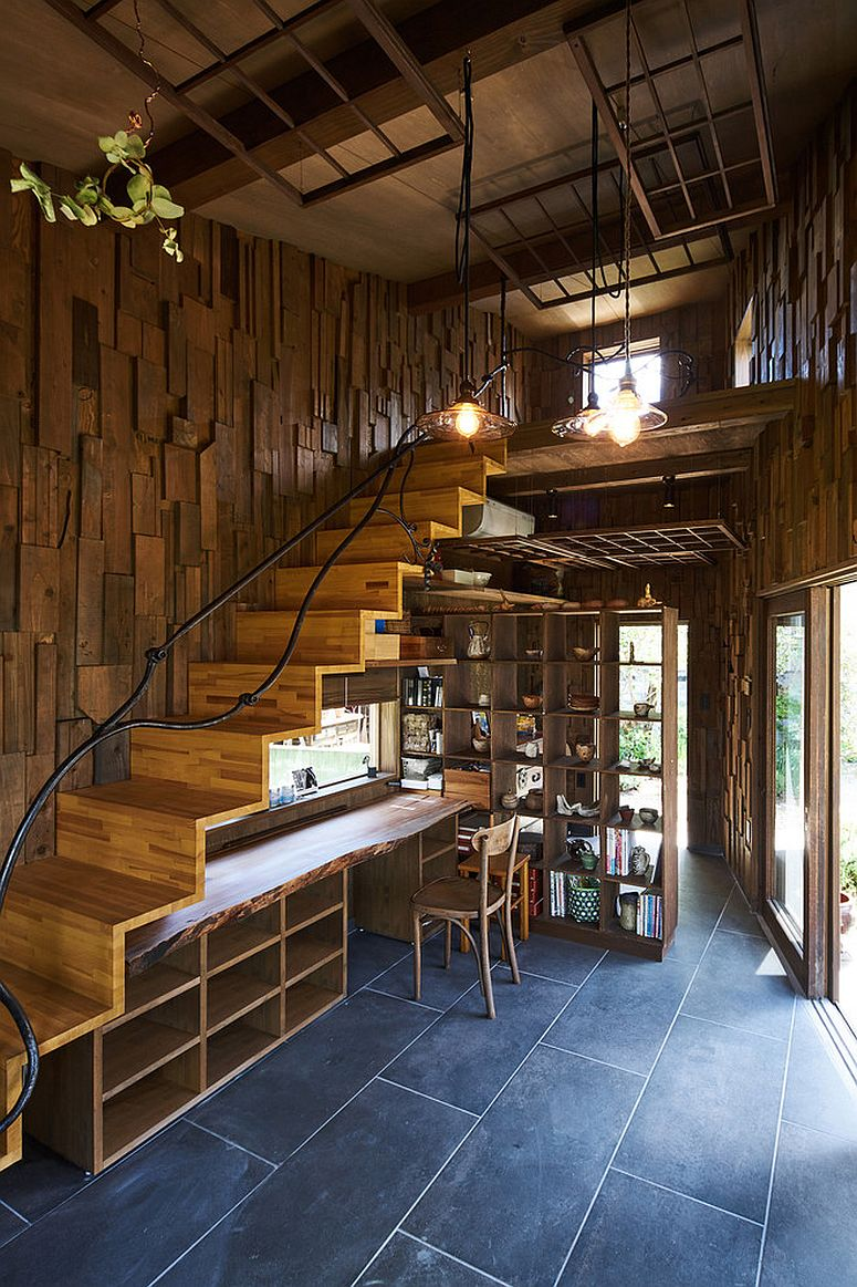 Unique home office next to the stairway with open wooden shelves