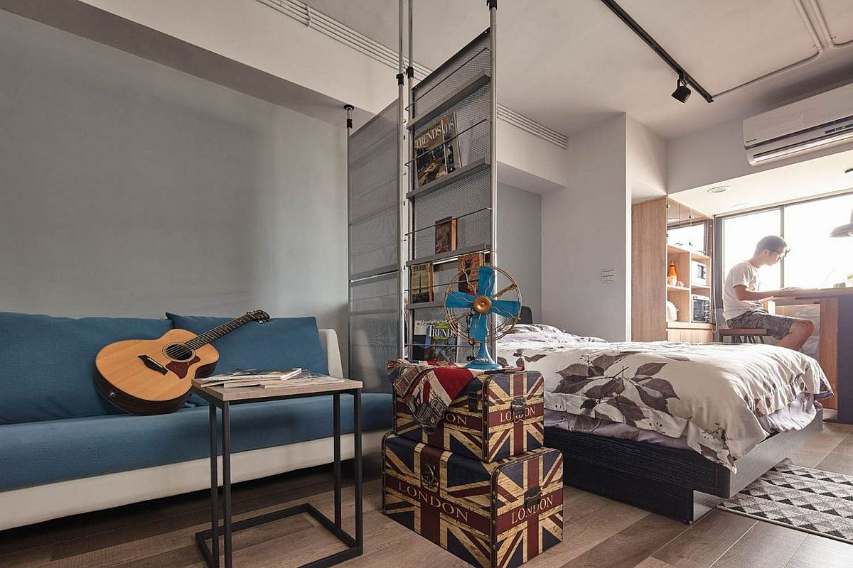 Vintage suitcases used both as storage space and a stand inside this tiny industrial style apartment