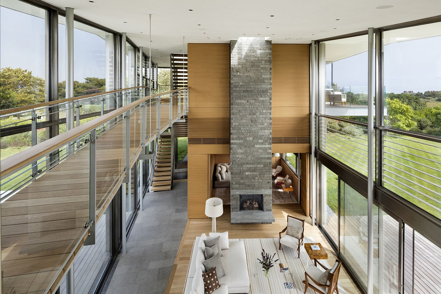 Walkway with silver-gray woooden planks runs throughout the house and outdoors