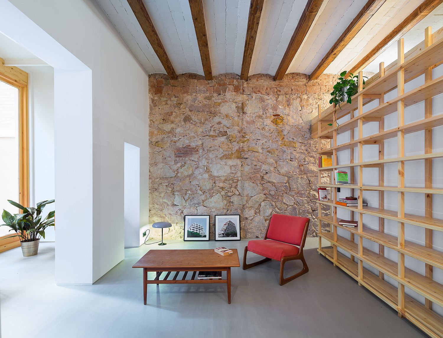 Wall of wooden shelves for the revamped Barcelona home