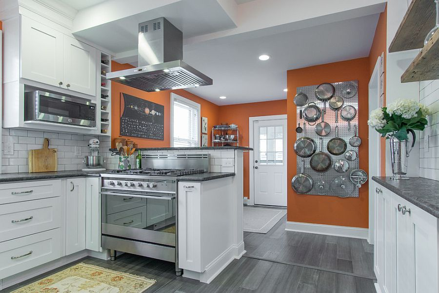 White kitchen with pops of orange and metal pegboard