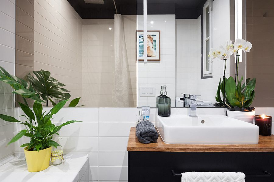 White sink, wooden countertop and dark bathroom vanity for the small modern bathroom