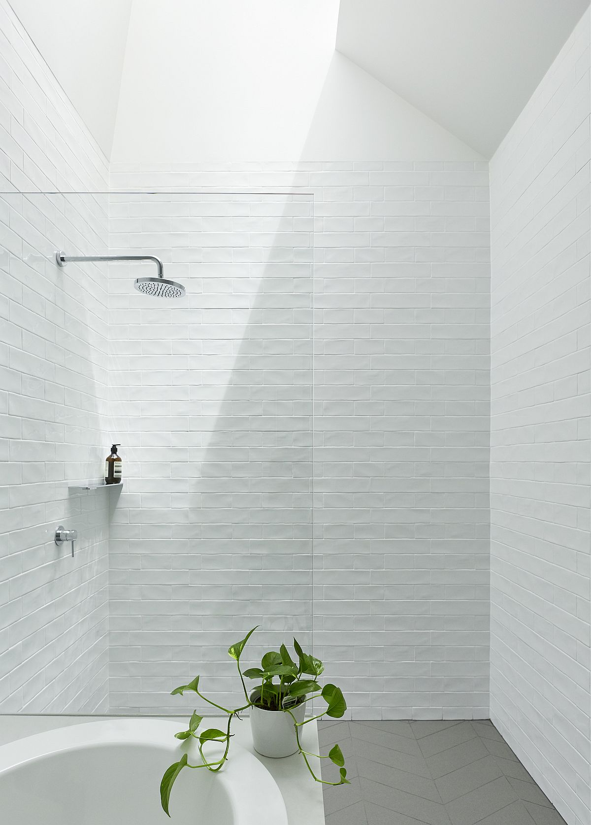White-textured-tiles-for-the-bathroom-with-skylight