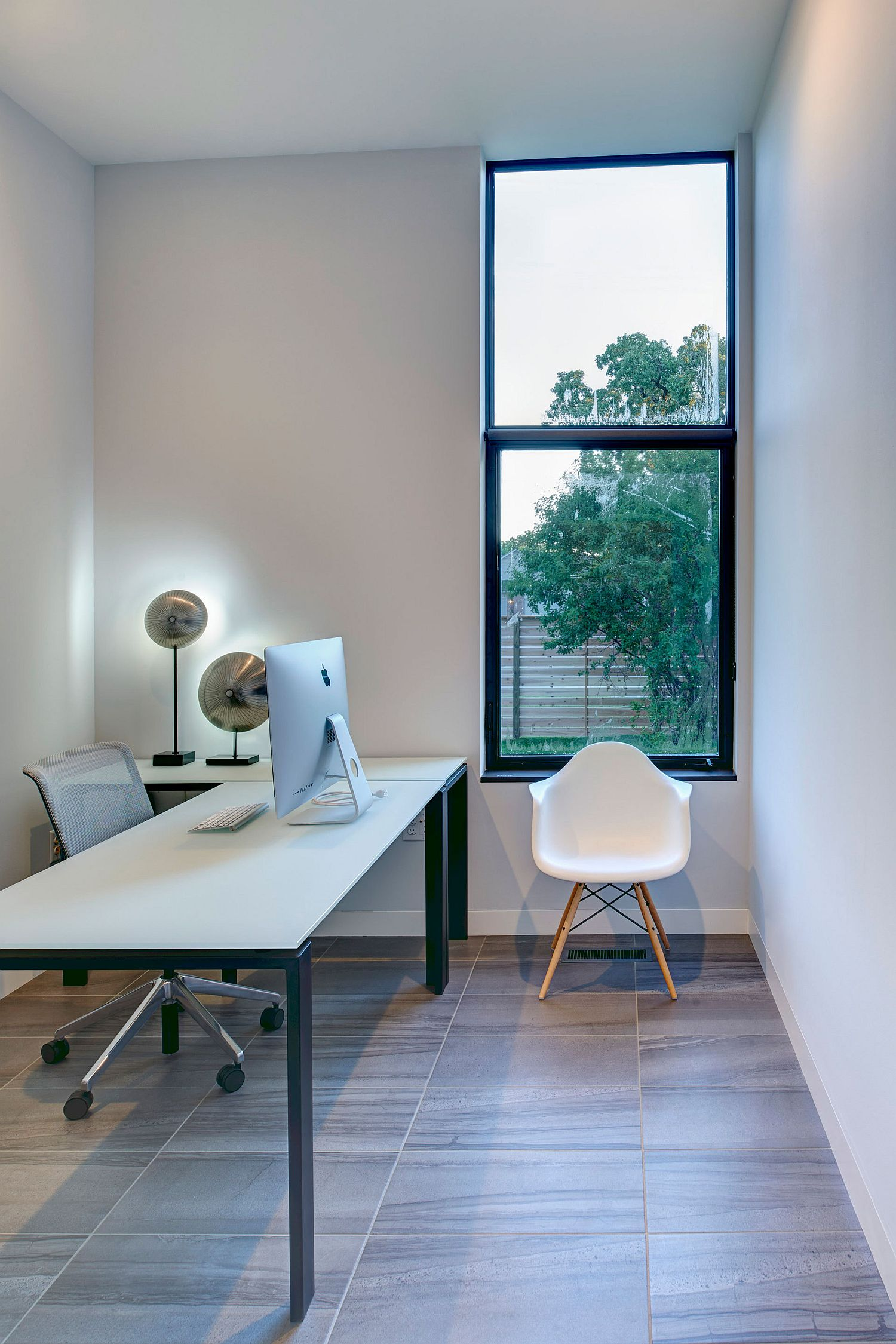 White home office with plenty of natural light