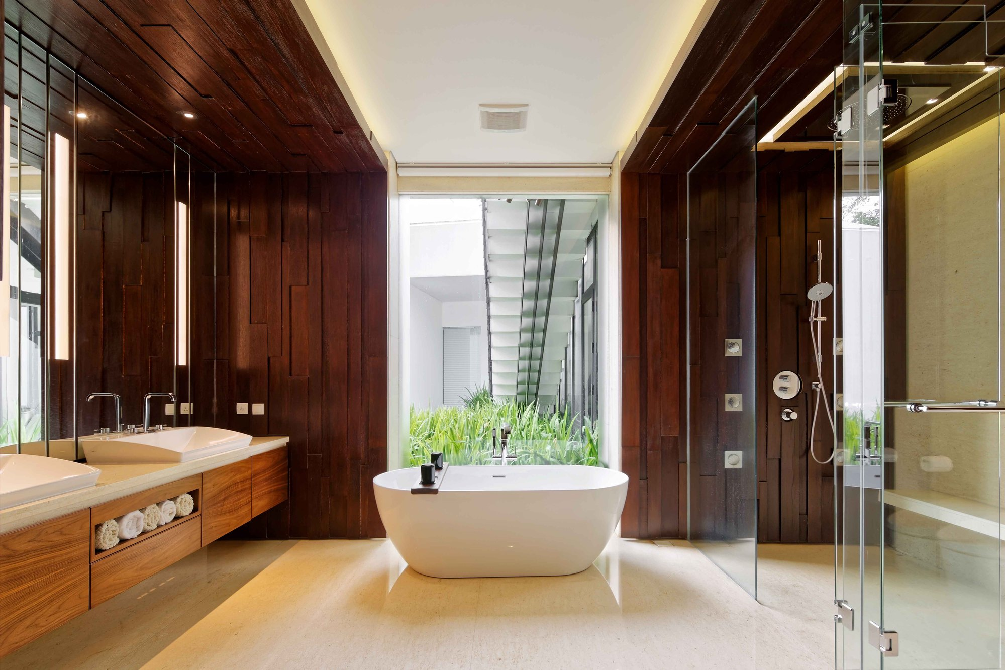 Wood adds warmth and textural contrast to the contemporary bathroom