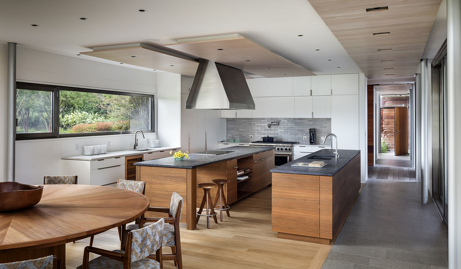 Wood and white create a sensational kitchen inside the Hamptons home
