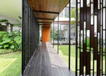 Wooden-decks-and-corridors-outside-the-house-connect-the-different-structures-217x155