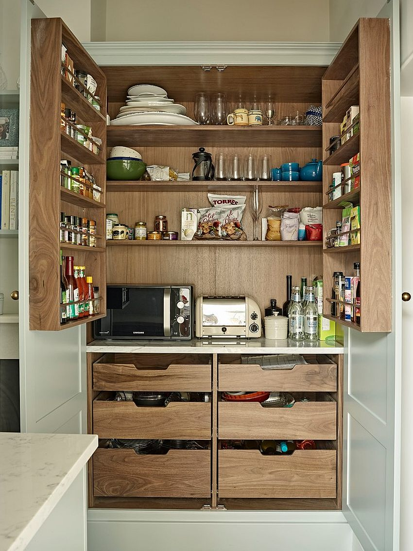 Wooden pantry opens up to reveal ample storage space