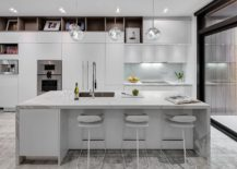 All-white-kitchen-of-the-house-with-a-stunning-central-island-217x155