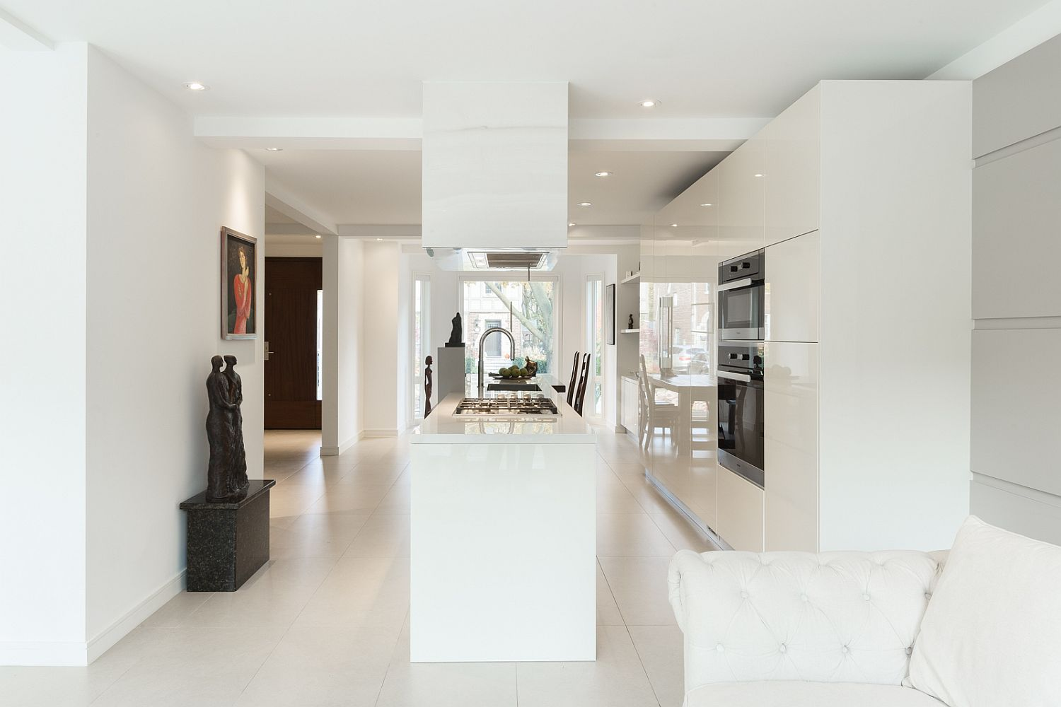 All-white living area and kitchen of the Art House