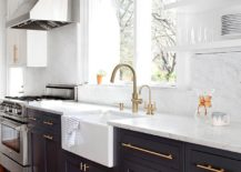 Brass-kitchen-fixtures-handles-and-lights-add-glitter-to-the-gray-and-white-kitchen-217x155
