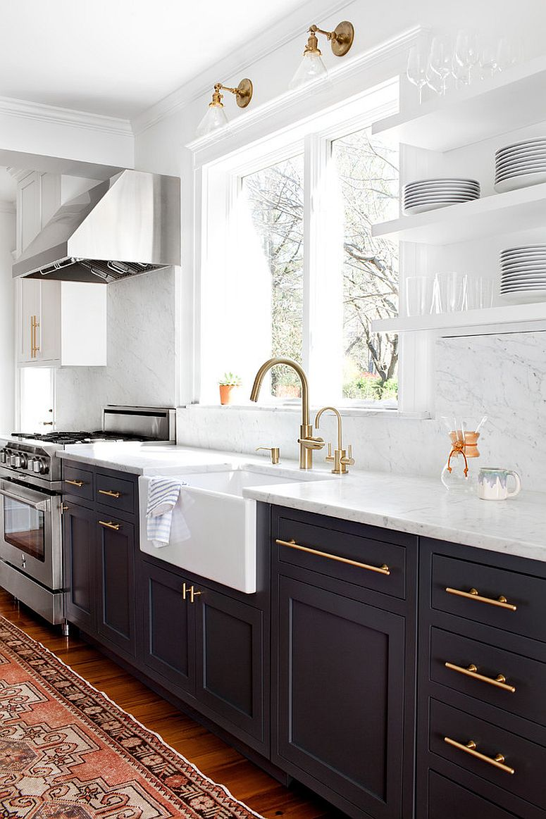 Brass kitchen fixtures, handles and lights add glitter to the gray and white kitchen
