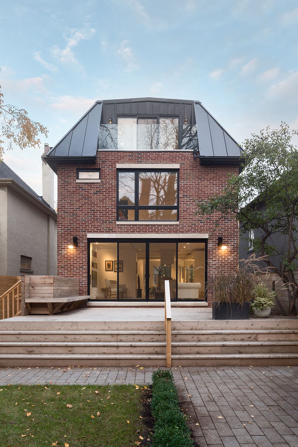 Brick, Bay Windows and roof form give the exterior a classic vibe