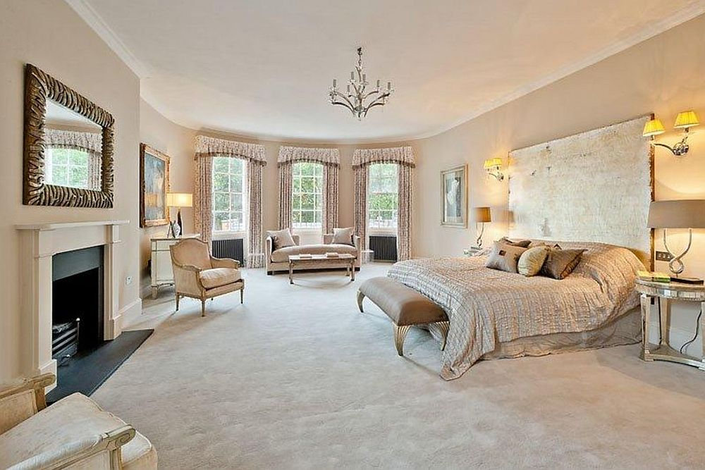 Curved walls and a world of beige greet you inside this bedroom