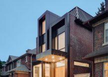 Dark-metallic-window-and-door-frames-give-the-exterior-a-unique-look-217x155