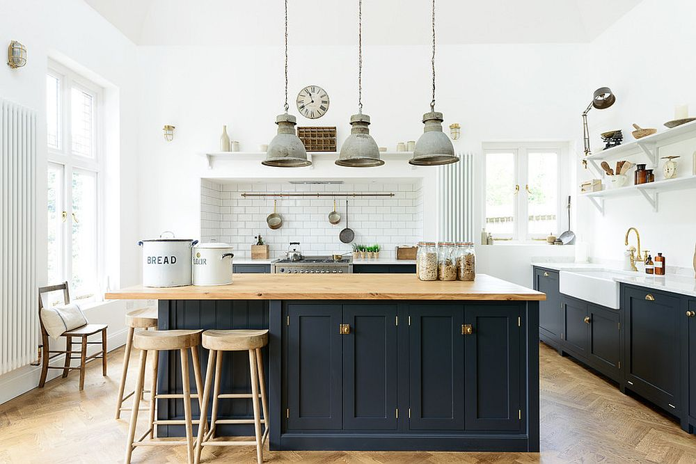 Fabulous industrial chic kitchen with navy blue island and custom pendants